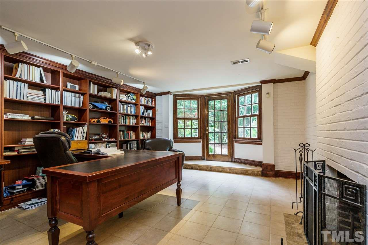 Grand office space with fireplace, built-ins, and access to the side yard. No need for that office? Picture the potential as kid play space (basement bonus) or studio-style living for older children and adults alike.