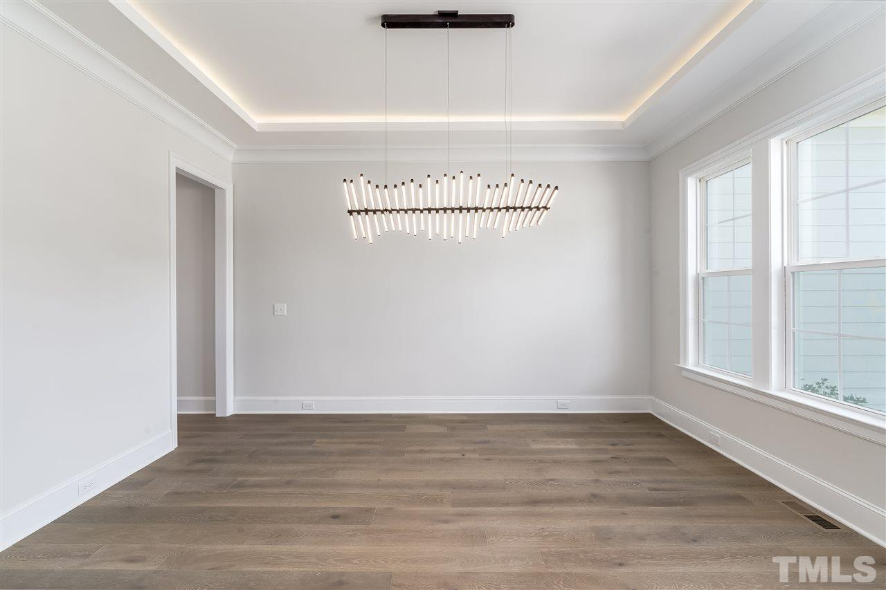 Just off the foyer! Custom trey ceiling with lighting!