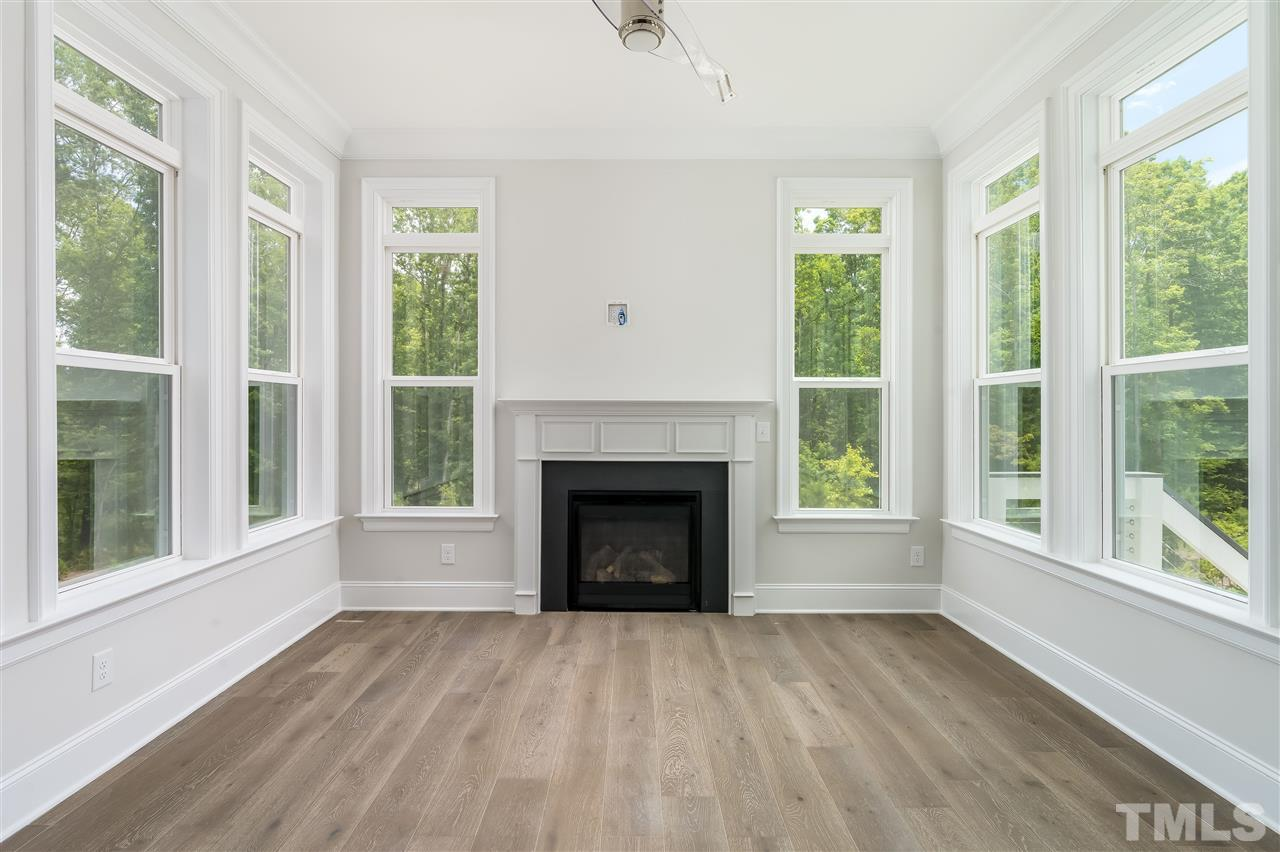 With fireplace and trex deck just beyond! Notice your view!