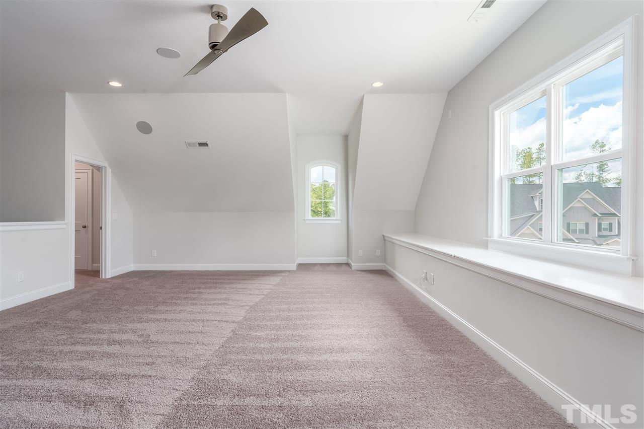 Another view of this spacious attic and bench for seating!