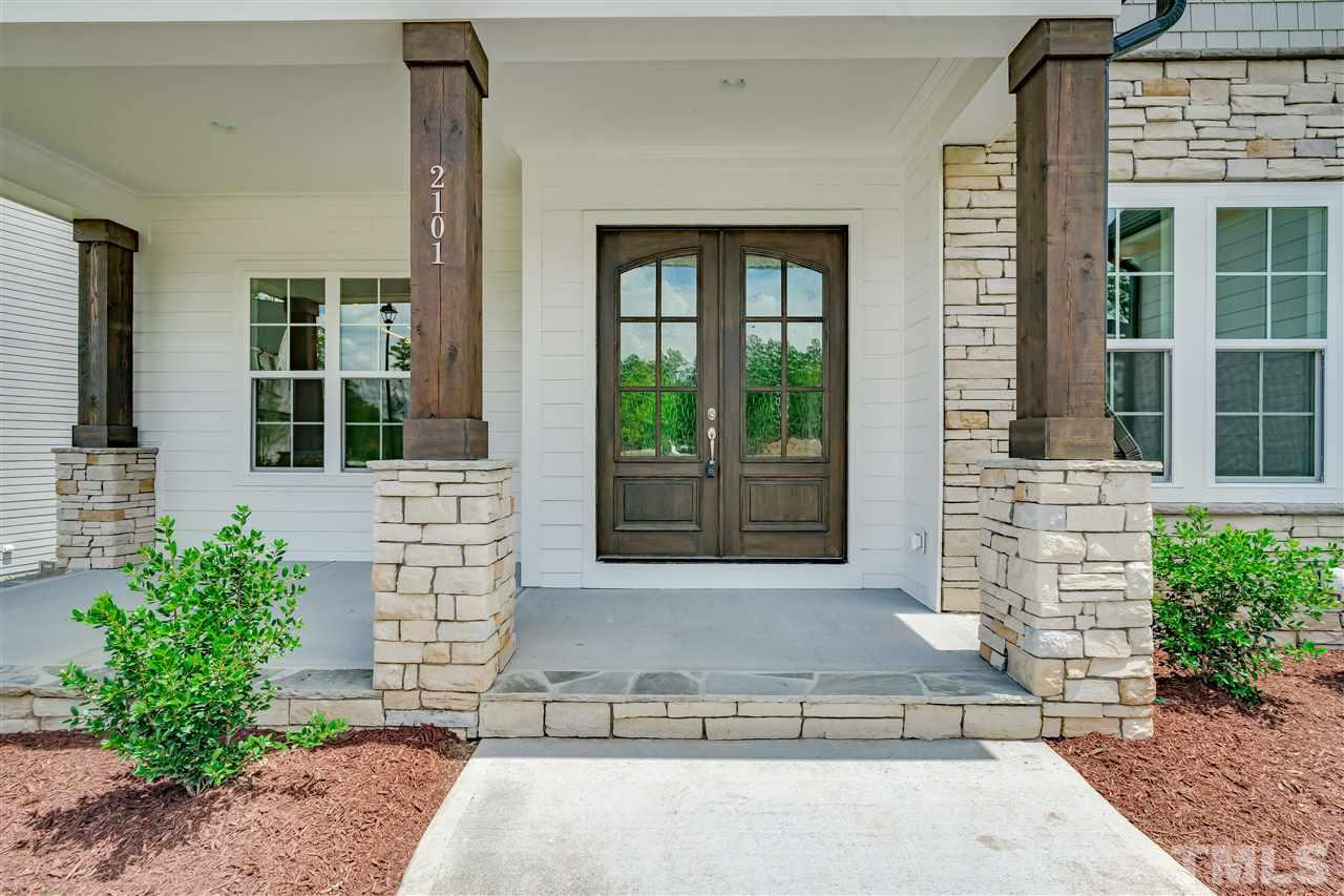 Covered front porch with stone...what an elegant entry!