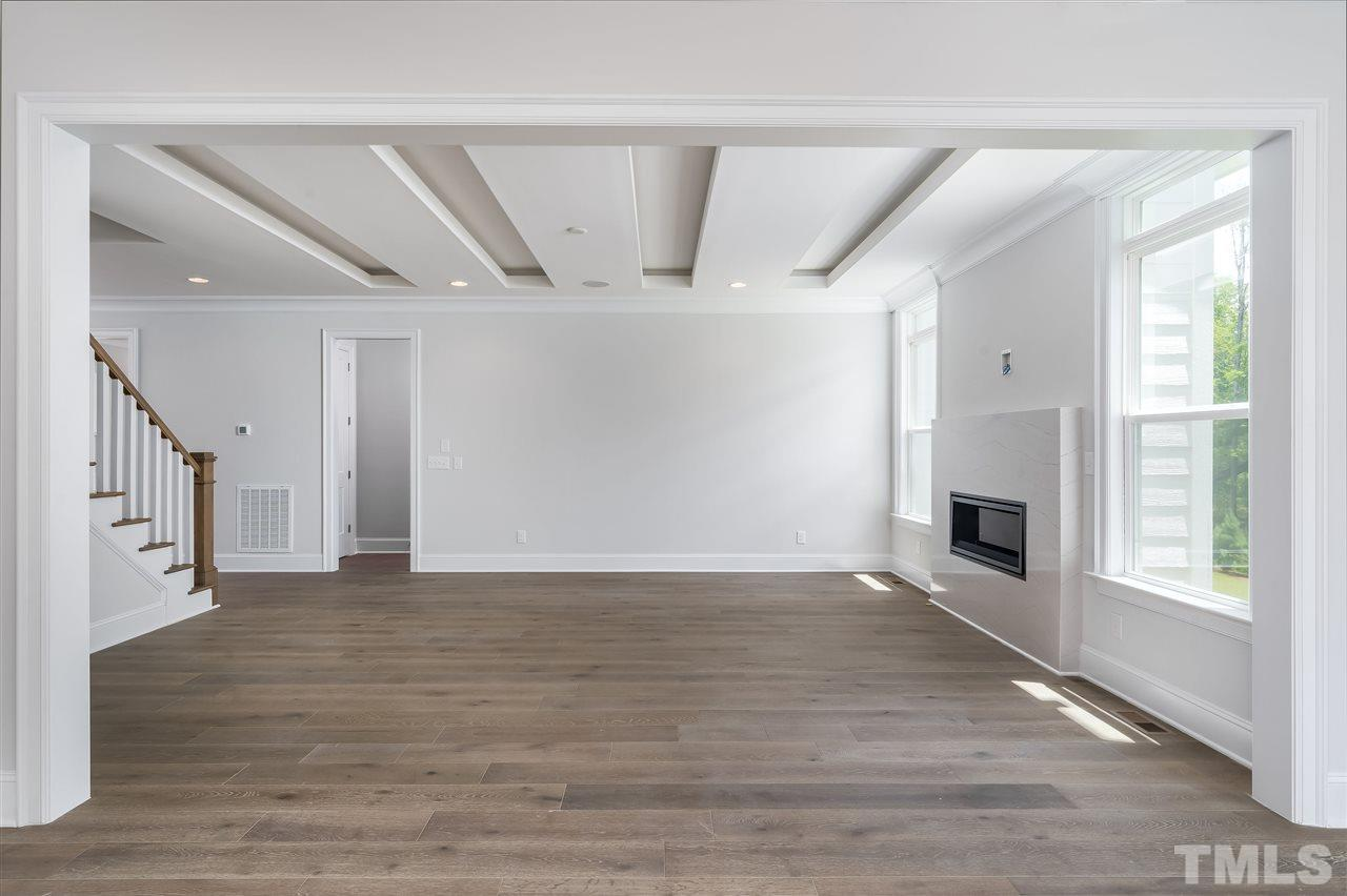 Open and spacious with elegant ceiling and lighting inside boxed ceiling!