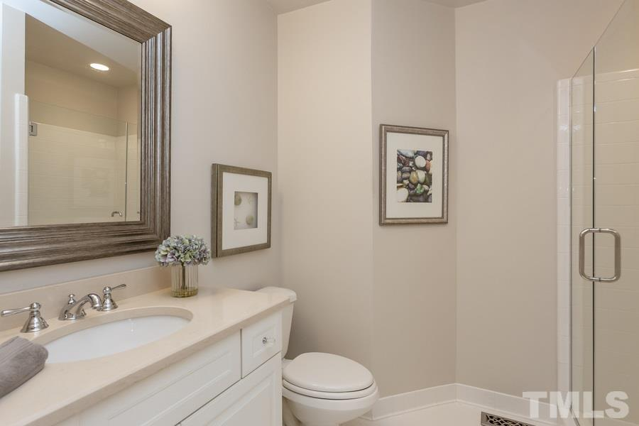 Remodeled bath joins flex bedroom/study space.