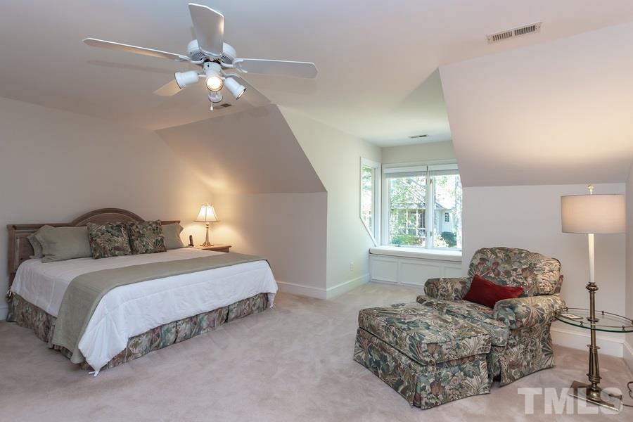 Huge bedroom with sitting area plus two closets and a cedar closet.  Walk out attic storage.