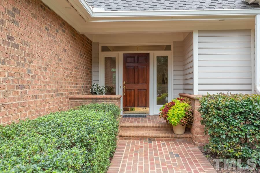 New concrete driveway and lovely brick walkway greet you as you approach the front porch.