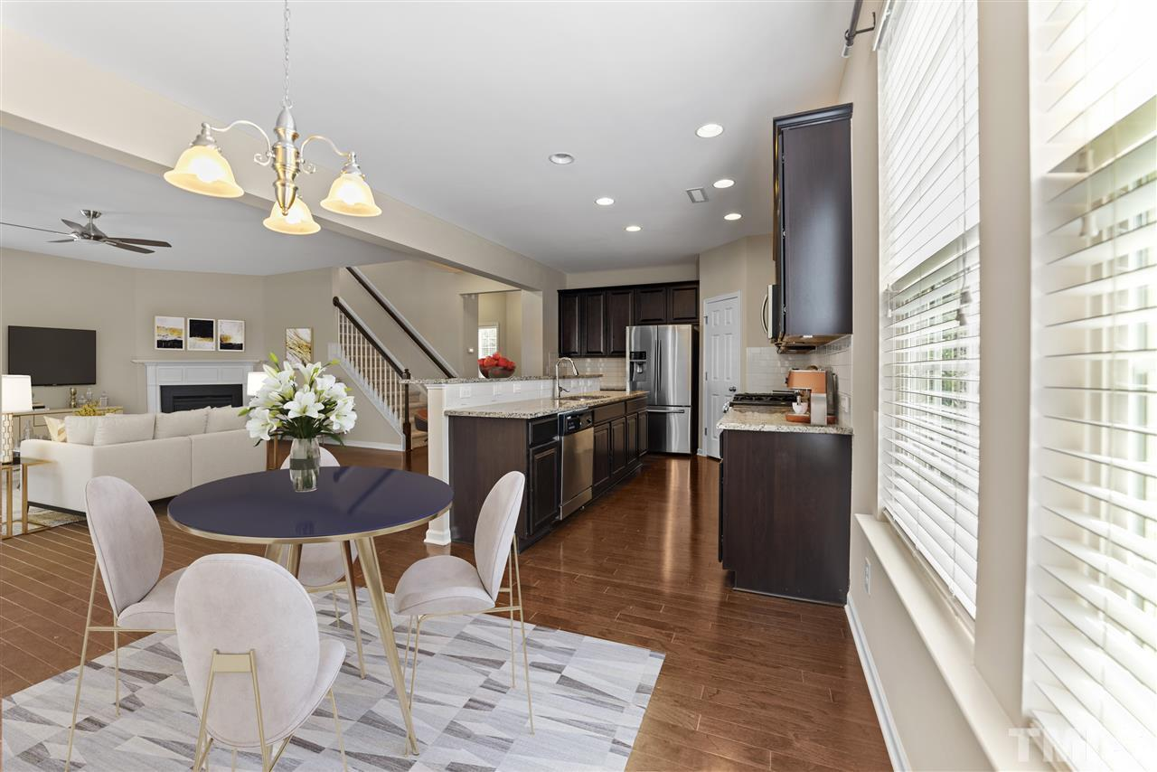 The breakfast room is beside the prep area of the kitchen and has been virtually staged in this photo.  It is a large space with great opportunity for furniture placement.