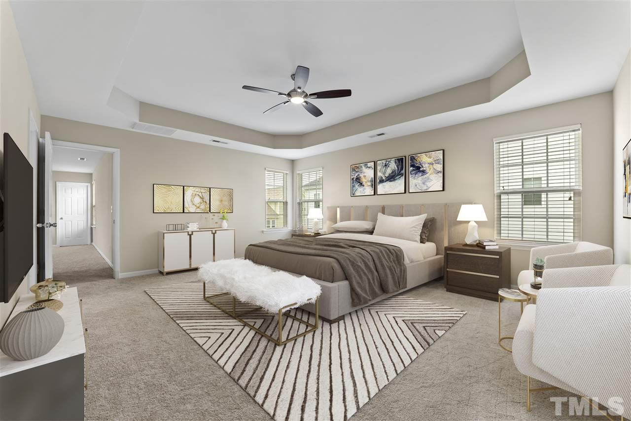 The master bedroom is huge with a trey ceiling and fan.  It has been virtually staged for this photo.  New carpet throughout the entire upstairs and first floor guest room, hardwoods throughout main living area on first floor.