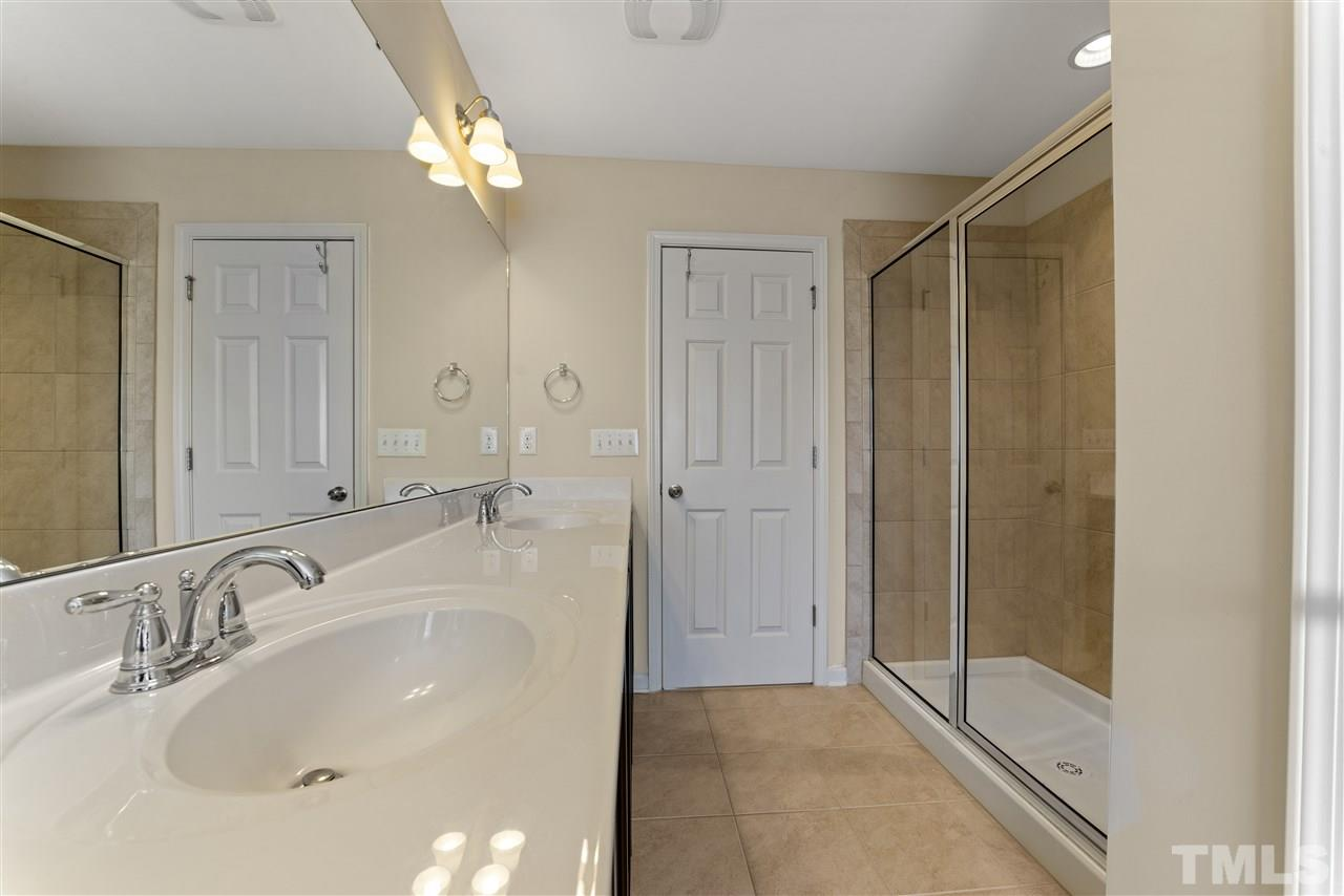 A closer view of the vanity and walk in shower.