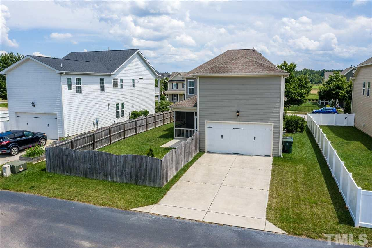 The 2 car garage is in the back of the home, but the backyard is a great size and fenced for privacy.