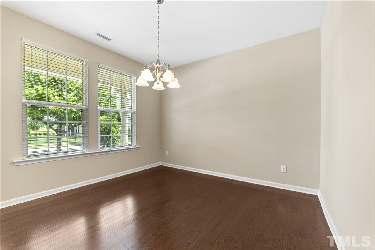 The dining/Flex room (virtually staged in the photo) is to the left as you enter the home.