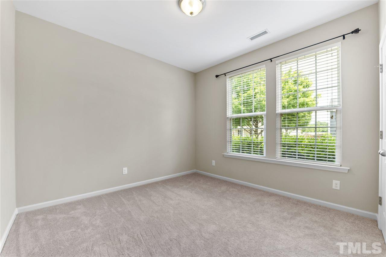 The guest bedroom on the main floor is tucked away to the right as you enter the home.  There is a full bath adjacent to the room.
