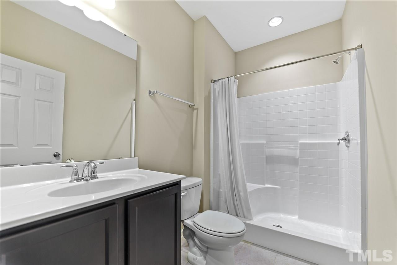 The first floor bathroom has a walk-in shower.