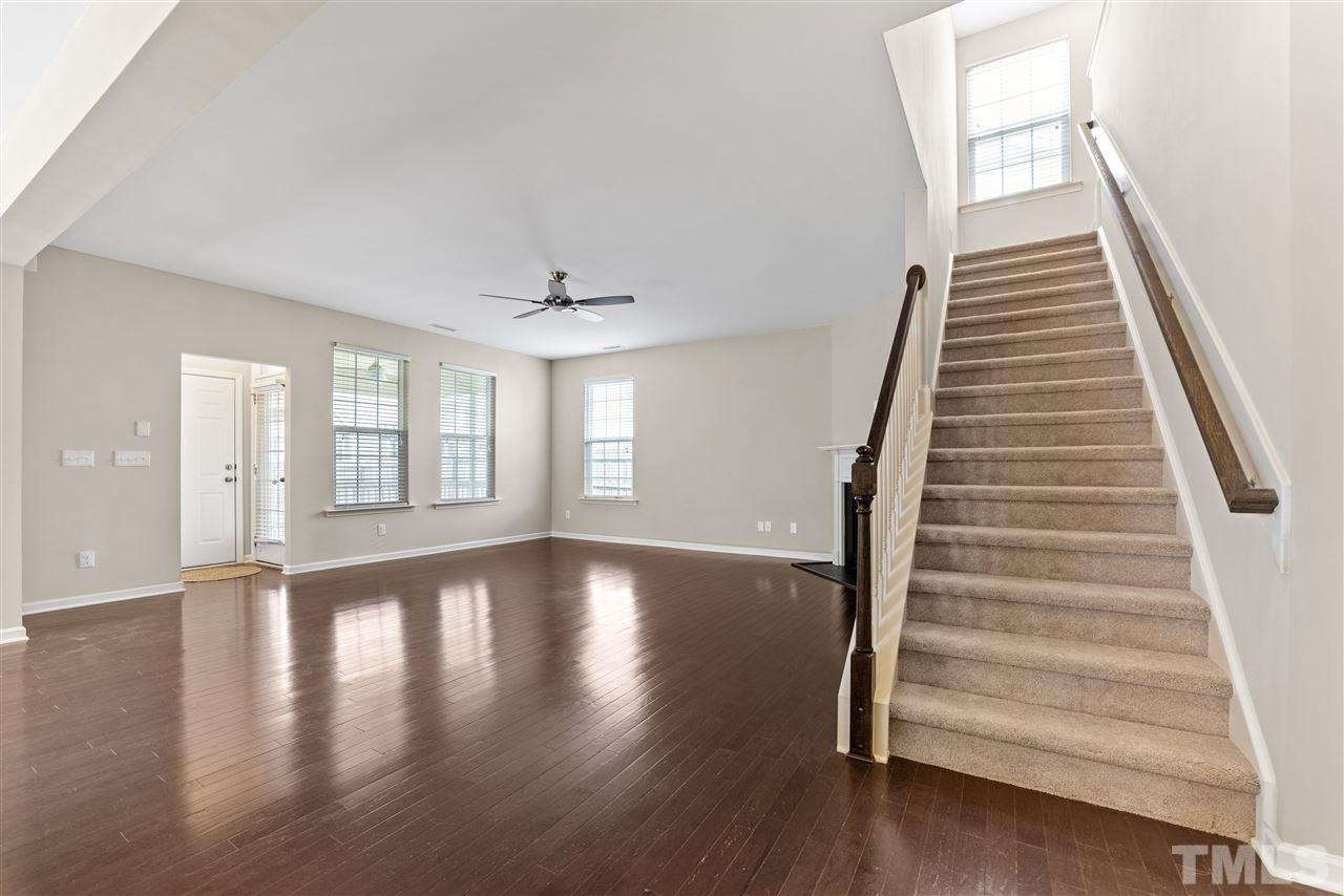 The main floor plan is very open with great space.  The family room has a gas log fireplace, ceiling fan and lots of windows.  Toward the back is the door to the screened porch, the door to the garage and one to the stairs leading to the bonus room.