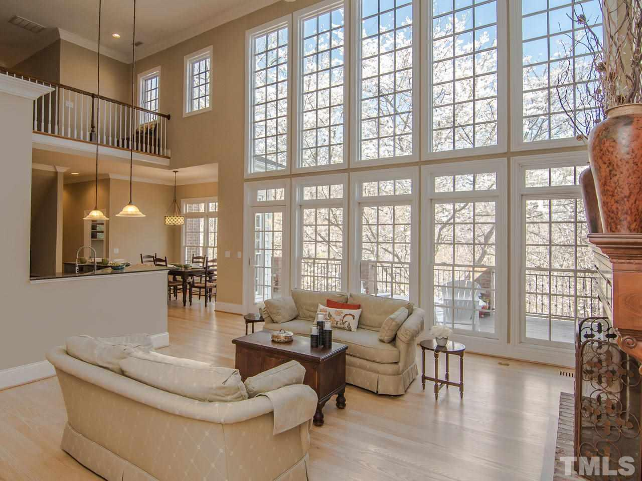 Great room with floor to ceiling windows that over look the backyard.