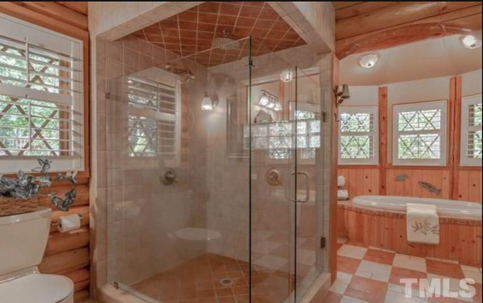 Walk in shower, double vanities, soaking tub, tons of windows and light