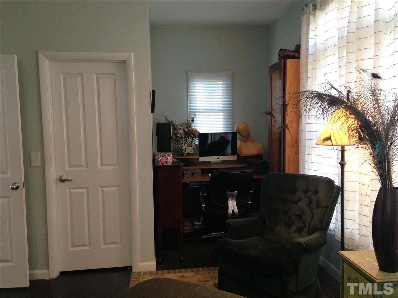 The downstairs bedroom has a recessed area that is perfect for a home office area.