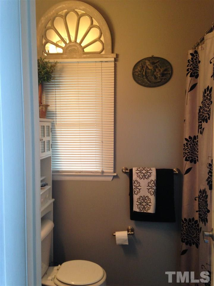 """This room is currently being used as a home office. It is on the 2nd floor in the tower and has a small """"weather-check"""" balcony that looks out over the playground and common area of Pacifica."""