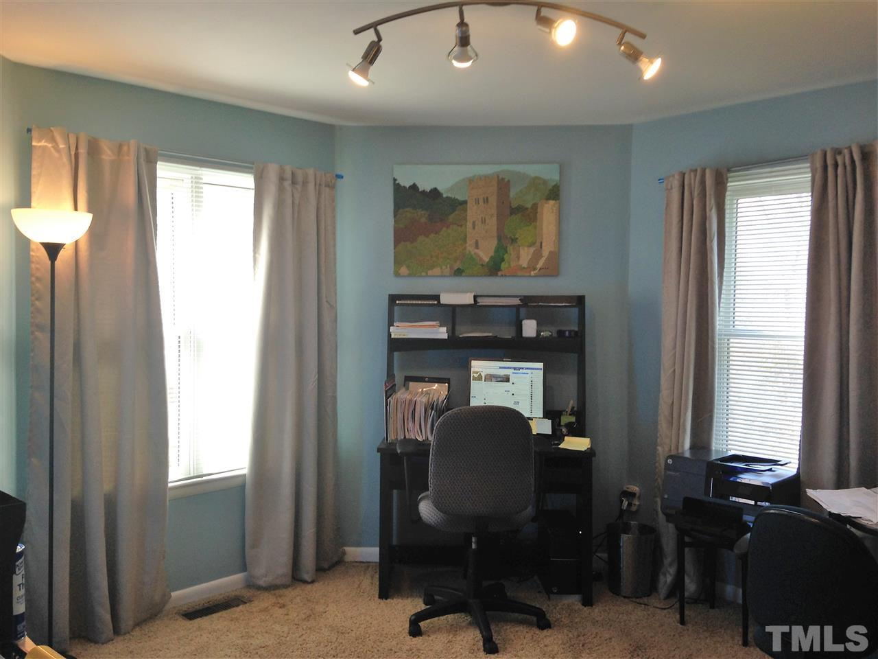 This 2nd floor bedroom (labeled the mancave) has it's own full bath and large closet. It has a recessed area that could be used for a desk or in this case, it has a bed tucked into it.