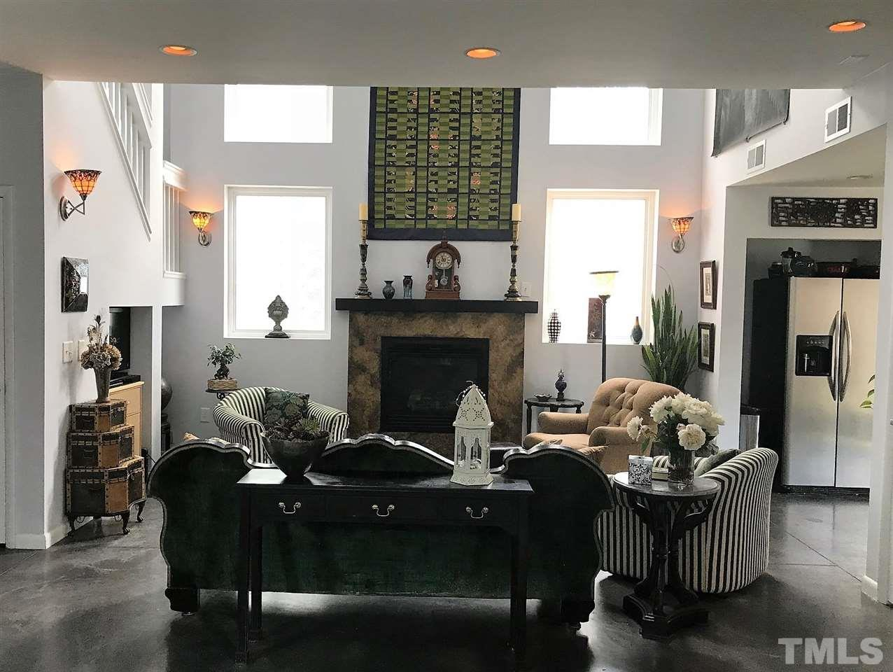 """The custom maple cabinets have pull out drawers, special spice shelves, round-abouts for easy access and interesting multi-level cap design. It also features Stainless steel appliances and dark green """"Emerald Butterfly"""" marble counters."""