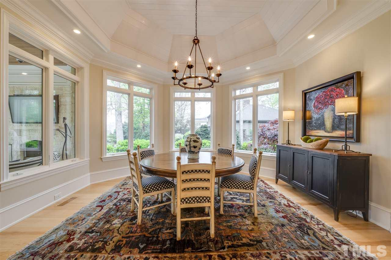 Custom designed ceiling, art and recessed lighting, plantation shutters, custom draperies.