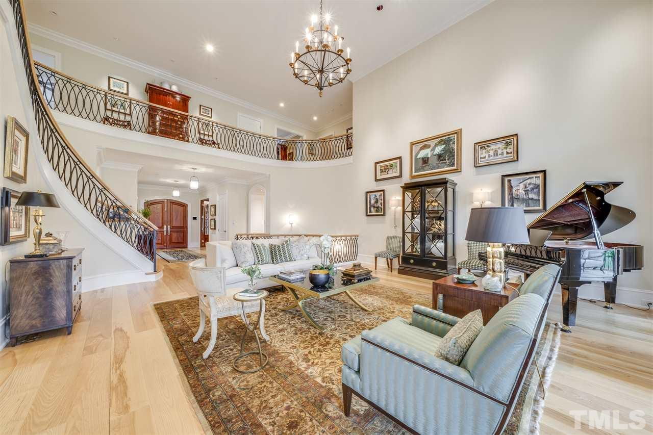 Golf course view, 2-story ceiling, walkout to Loggia, sconces, art and recessed lighting.