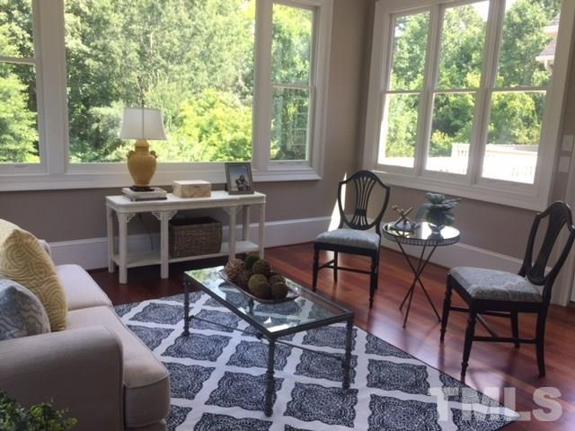 The windows in the back of the home no longer have dividers...clear glass and a huge picture window allow you to fully absorb the beauty of the private backyard.