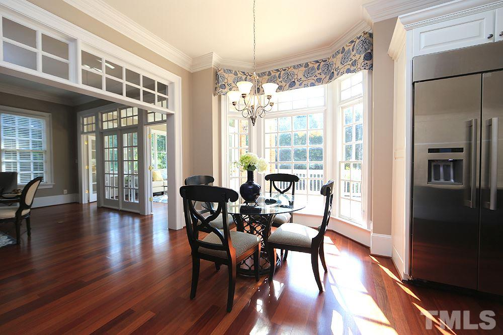 The breakfast room now has a huge picture window with no grates with clear, operable windows on each side.  Breakfast room is open to family room.