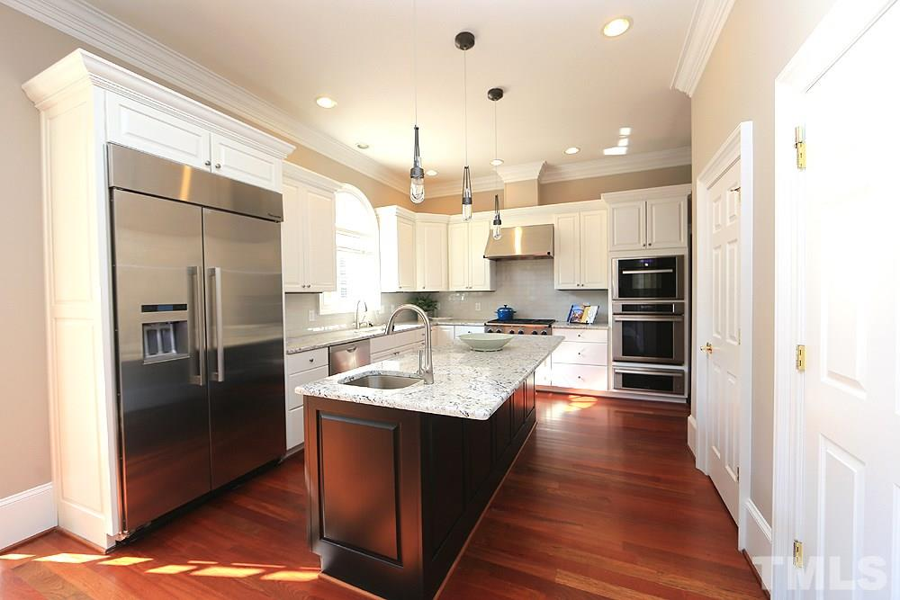 The pictures don't do the kitchen justice.  Come see for yourself...tons of counter space, a huge island with vegetable sink, high-end appliances are several years new, remodeled with painted cabinets, new granite and tile backsplash and faucets.