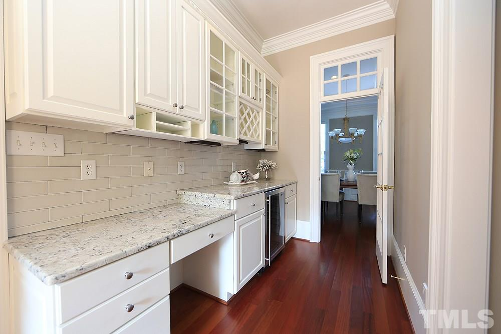 There is room for 4 stools at the island.  One of the doors on the wall is a pantry, the other leads to the basement.