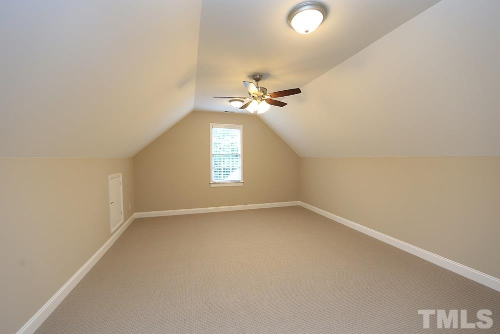 A second set of steps from the back hall leads to the bonus room with wet bar.  There are ceiling fans in the bonus, bedrooms, family room and exercise room.