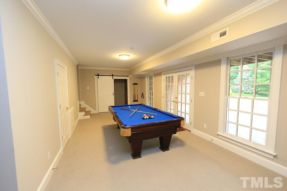 The exercise room is not included in the heated square footage.  We are not sure if this was originally finished or finished by the prior owner, but it is in the same quality as the rest of the home.