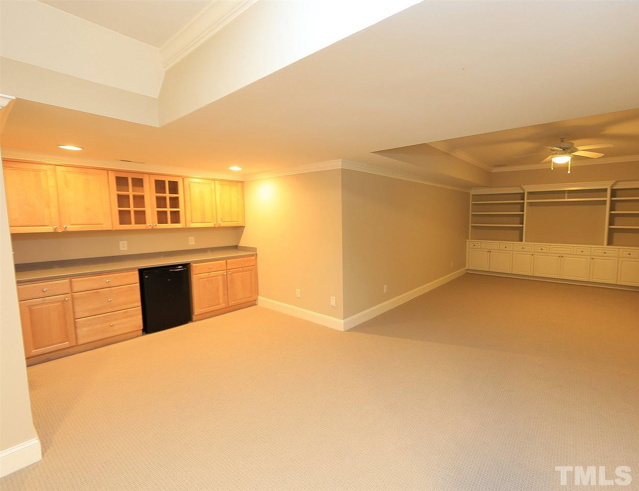 The lower level home office space is huge!  Concrete stained floors and custom cabinetry with quartz counters make this a fabulous place to work from.  Doors and windows have also been replaced with no grates.