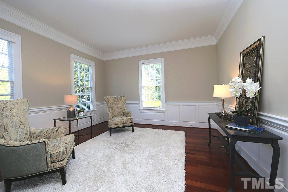 This room with French doors can serve many purposes depending on your lifestyle.  Windows in the front and on the side provide lots of natural light.  Brazilian Cherry Hardwoods grace the main floor along with the upper hallway.