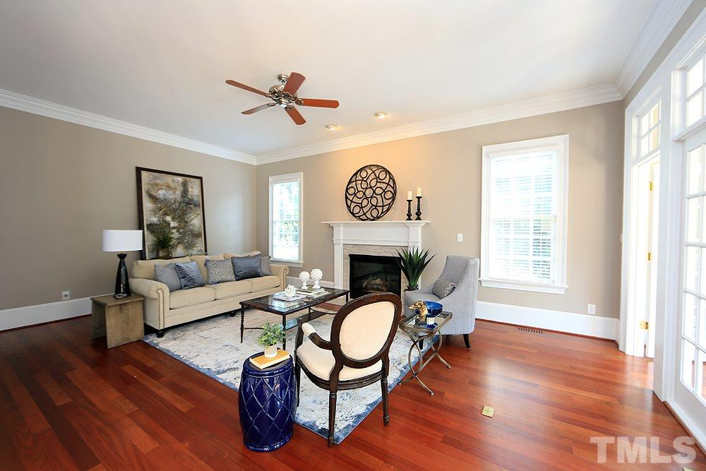 The family room is cozy and features a gas fireplace flanked by 2 windows.  The surround for the fireplace was just modernized.