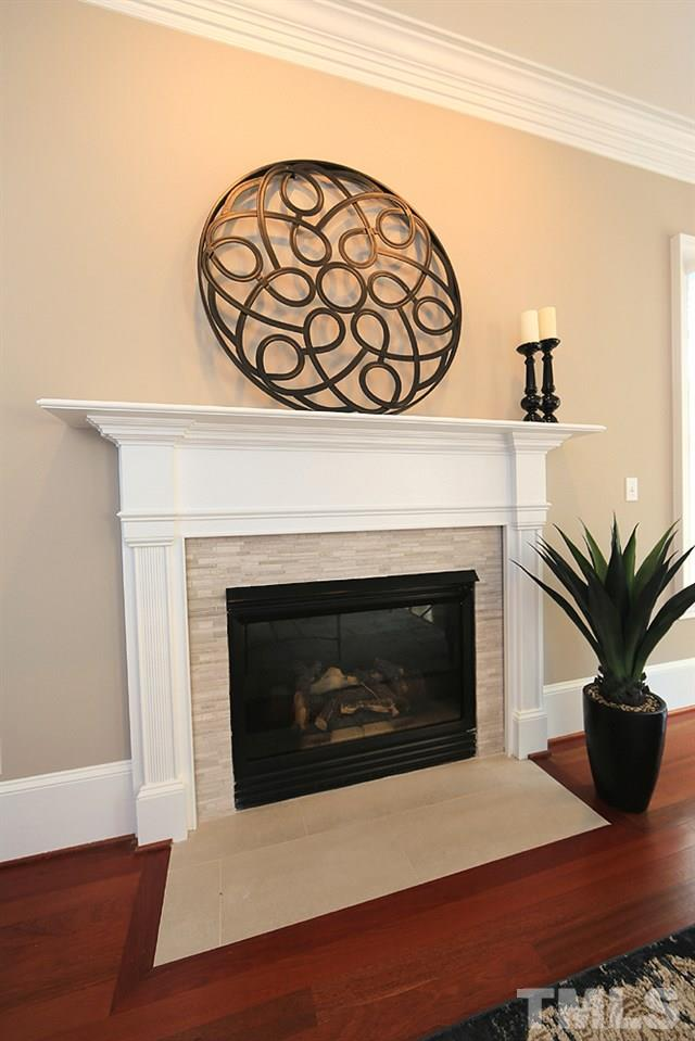 A closer view of the fireplace surround.