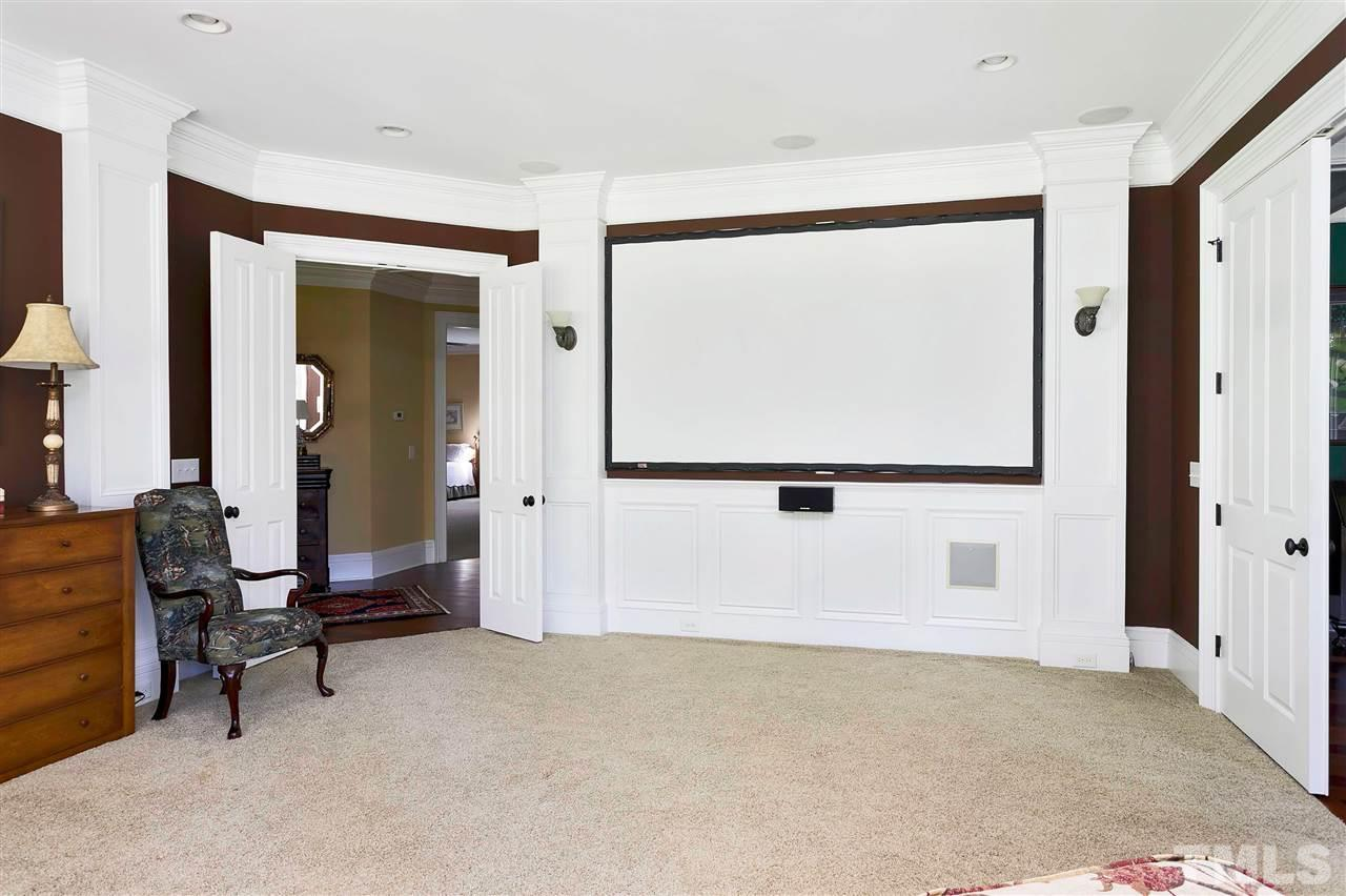 The Media Room Projection Screen is 9' x 5'.   The 8 point surround sound speaker system brings movies and television programs right into the room with high definition sound and picture - Popcorn anyone!