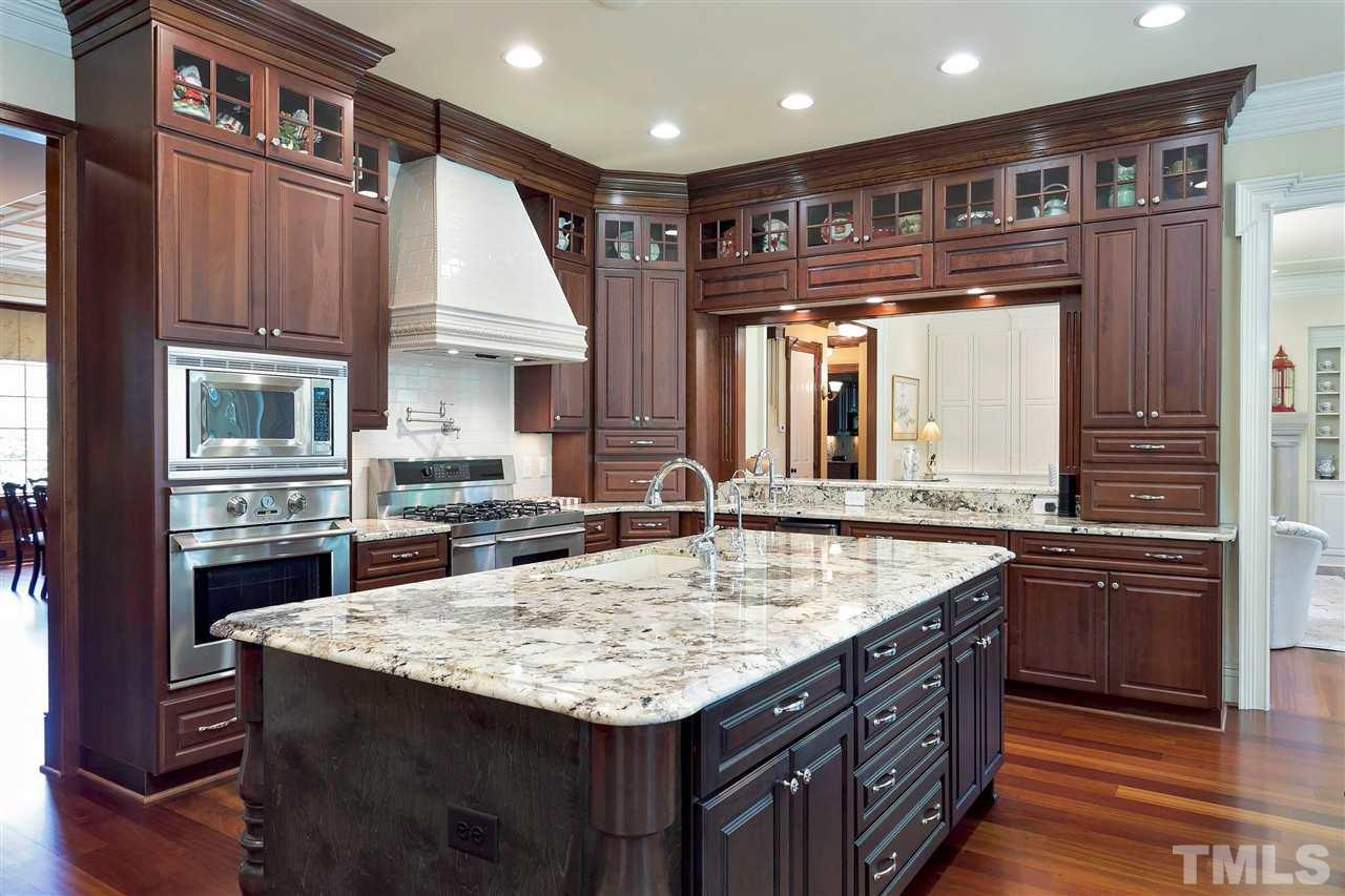 The range is dual fuel with six gas burners and a pot filler - PLUS a microwave & convection oven provide many options for food preparation.  Abundant cabinets, butler's pantry & dish & small appliance storage (not seen) make this kitchen MAGNIFICENT!