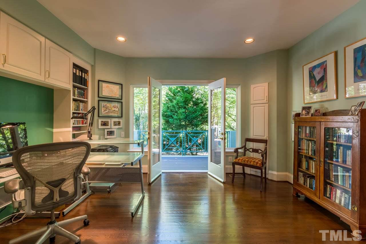 Another space that can be multi-purposed. Here it is as an office, with deck access and in the next photo as a guest room, the built-in to the left will accommodate a queen size bed. With a Murphy Bed you could have your cake and eat it too.