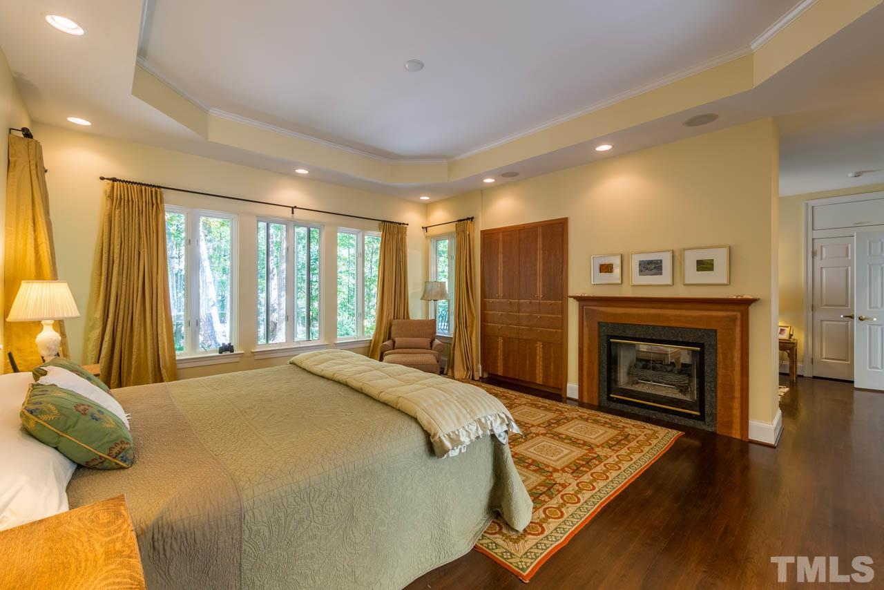 The master is spacious and has a fireplace and local craftsmen Aventine built-ins that negate the need for dressers.