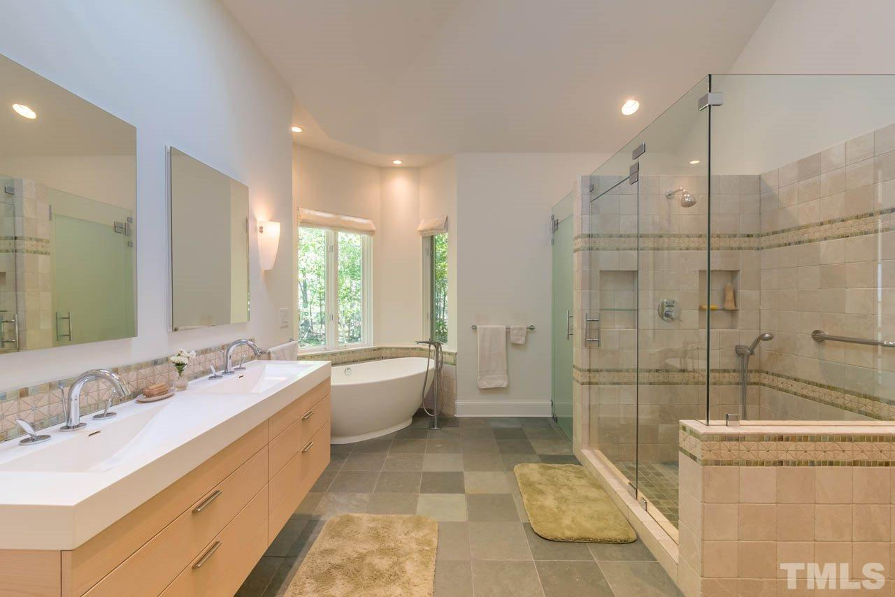 Beautifully redone a few years ago by local legend McLean Building Co. the master bath is a retreat unto itself.