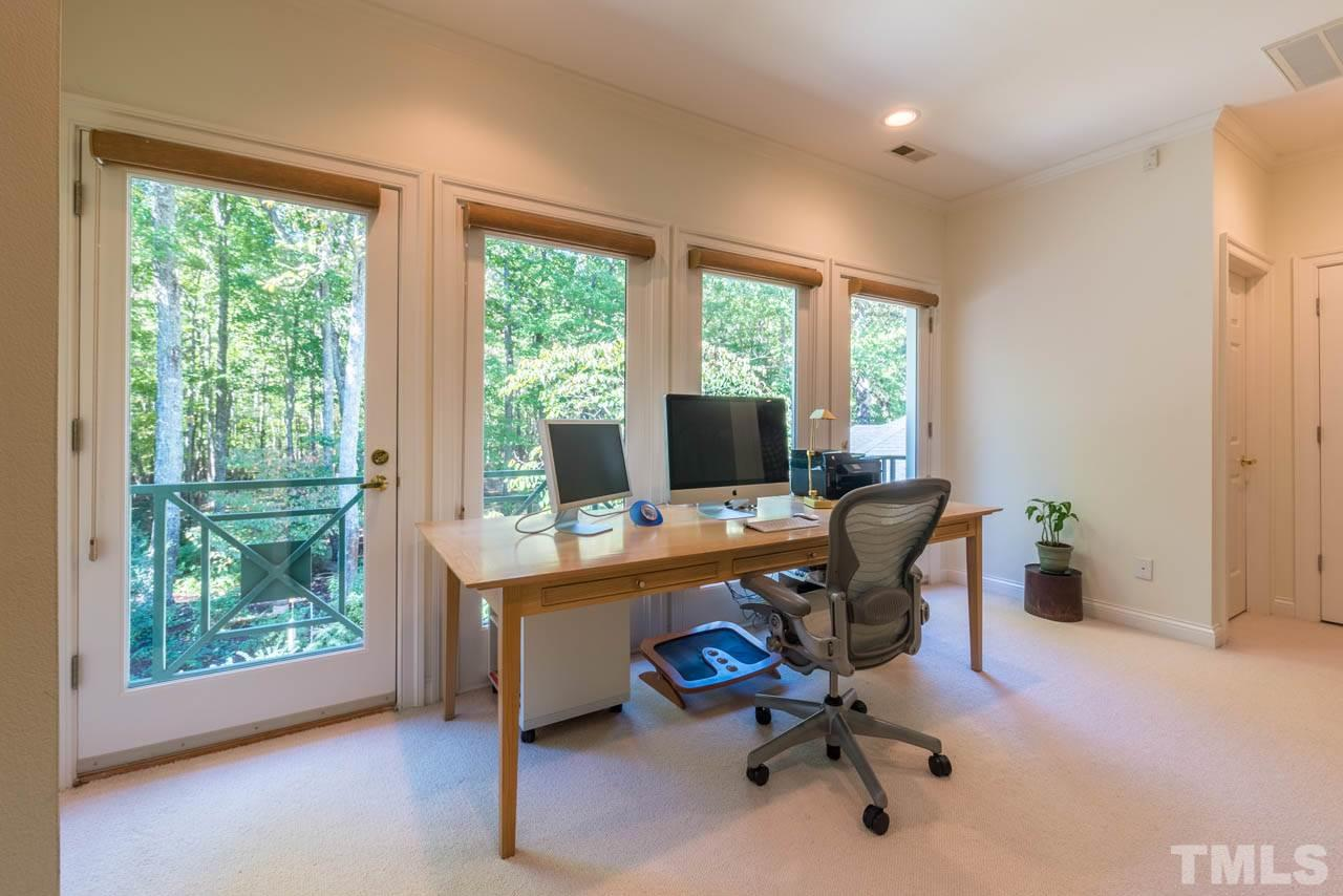 Seller loved having an office in this lofted space with it's garden views and Juliette Balconies, but it makes an equally delightful sitting area too.