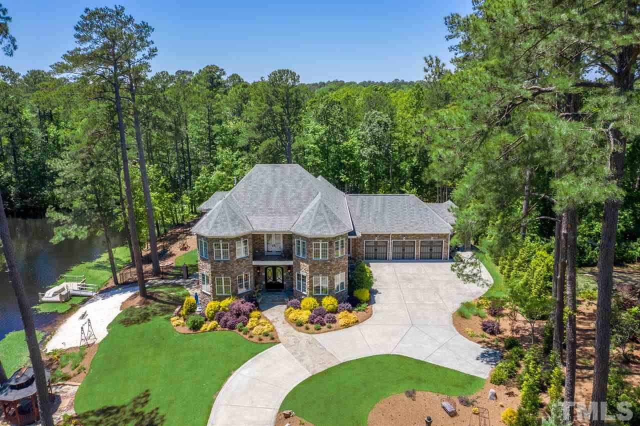 Completely custom solar home nestled at the end of a cul-de-sac, backing up to Enchanted Oaks million dollar neighborhood. Home is all stone and brick-no siding. Special order roof tiles. Handmade hardware for garage doors.