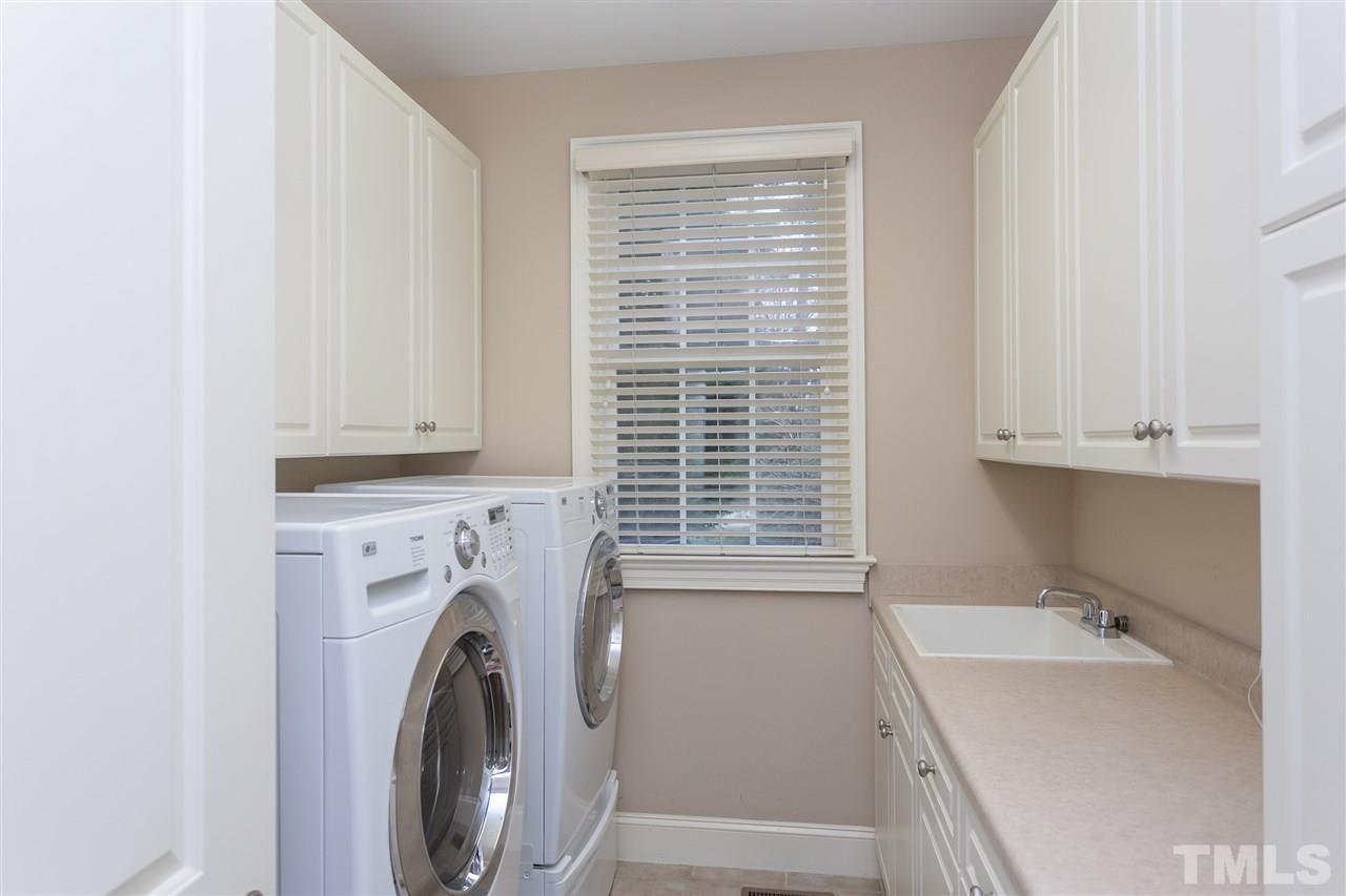 Enjoy a bright and shiny laundry room with full size tub, plenty of cabinets on both sides, all conveniently located on the spacious first floor.