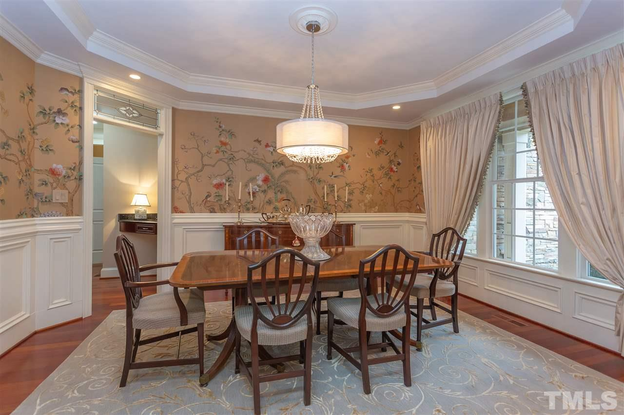 Elegant dining room with trey ceiling, crown molding, exquisite wainscot, and wall covering from London!