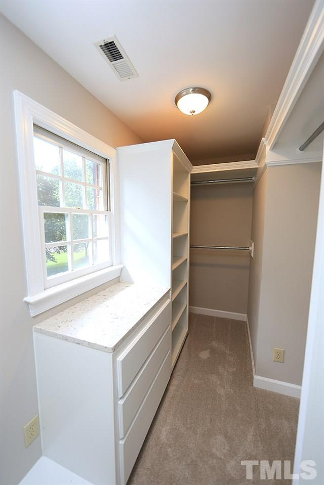 One of the master closets off master bedroom. Custom built in drawers, granite counter on cabinets.