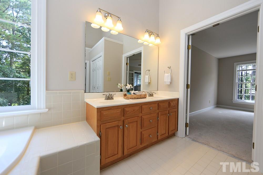 Master bath has double sinks, garden tub, and separate shower.