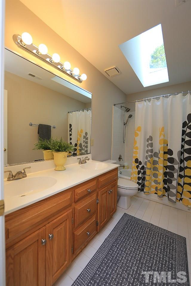 Full bath in upstairs hallway. New skylight and double sinks.