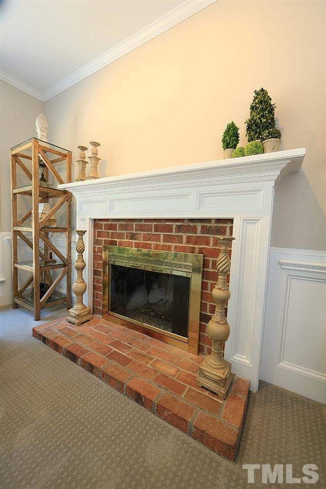 Family room has wood burning fireplace.