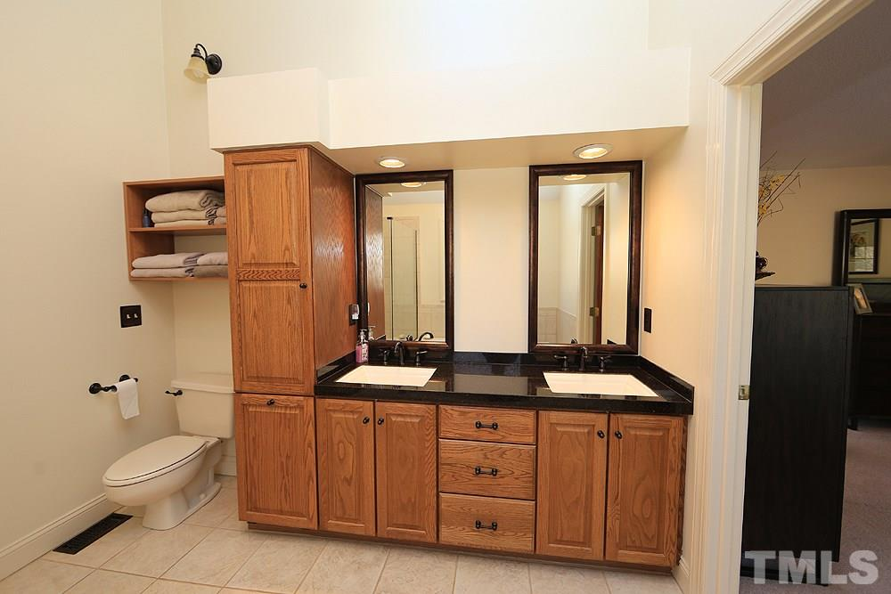 Plenty of room to get ready for the day with his and her sinks.