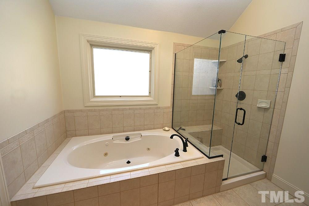 Tub with separate shower.